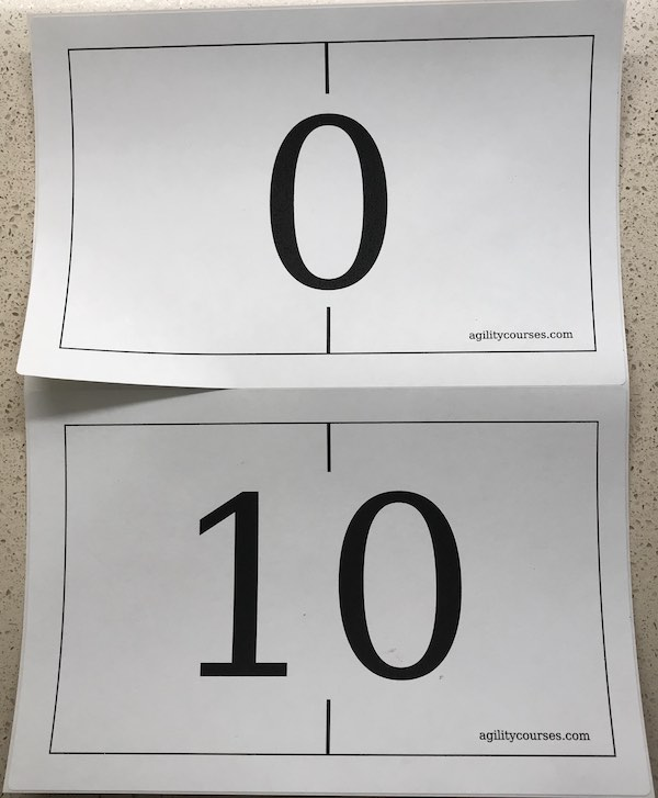 Image of two wall numbers showing one half page sticker being peeled up